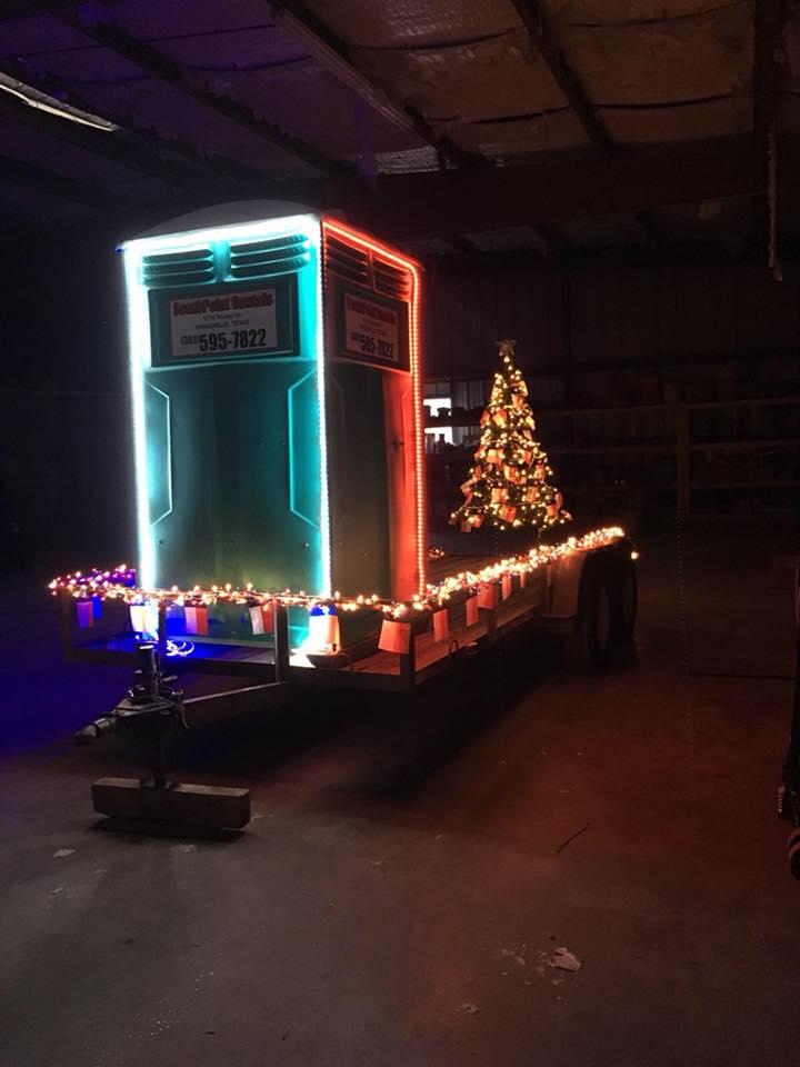 Christmas-themed portable toilet unit