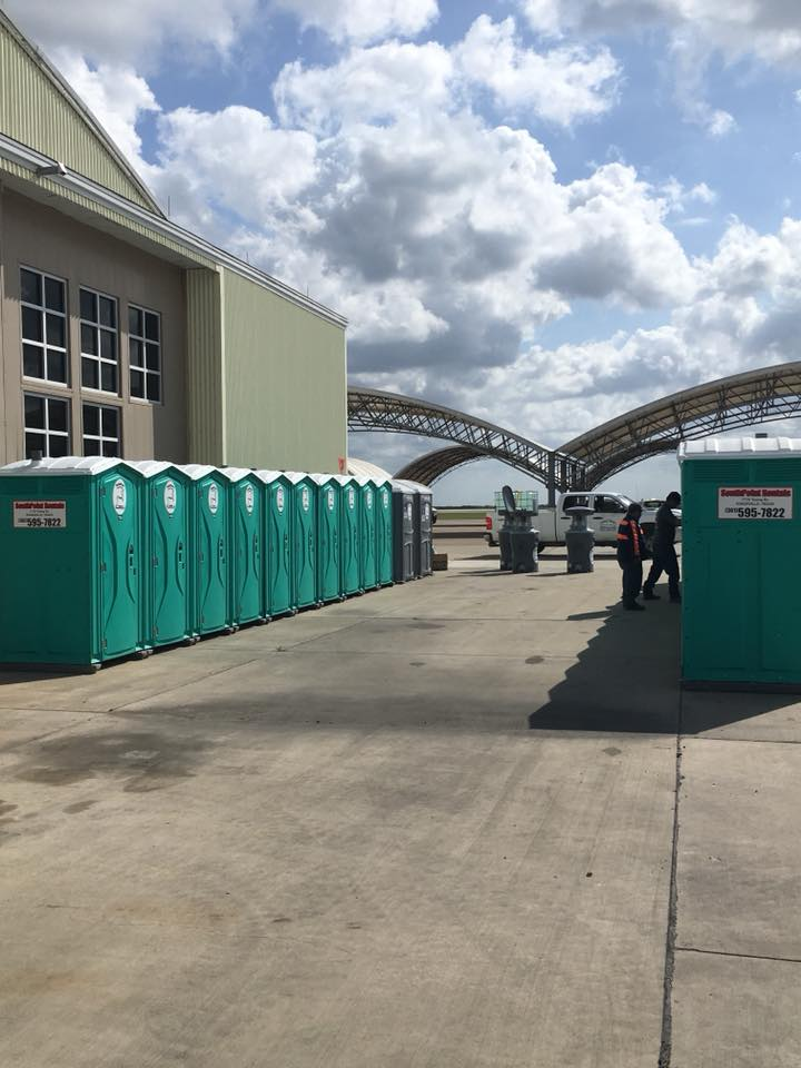 Two rows of portable toilet units