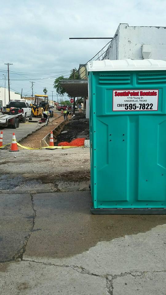 Portable toilet unit near a demolition site