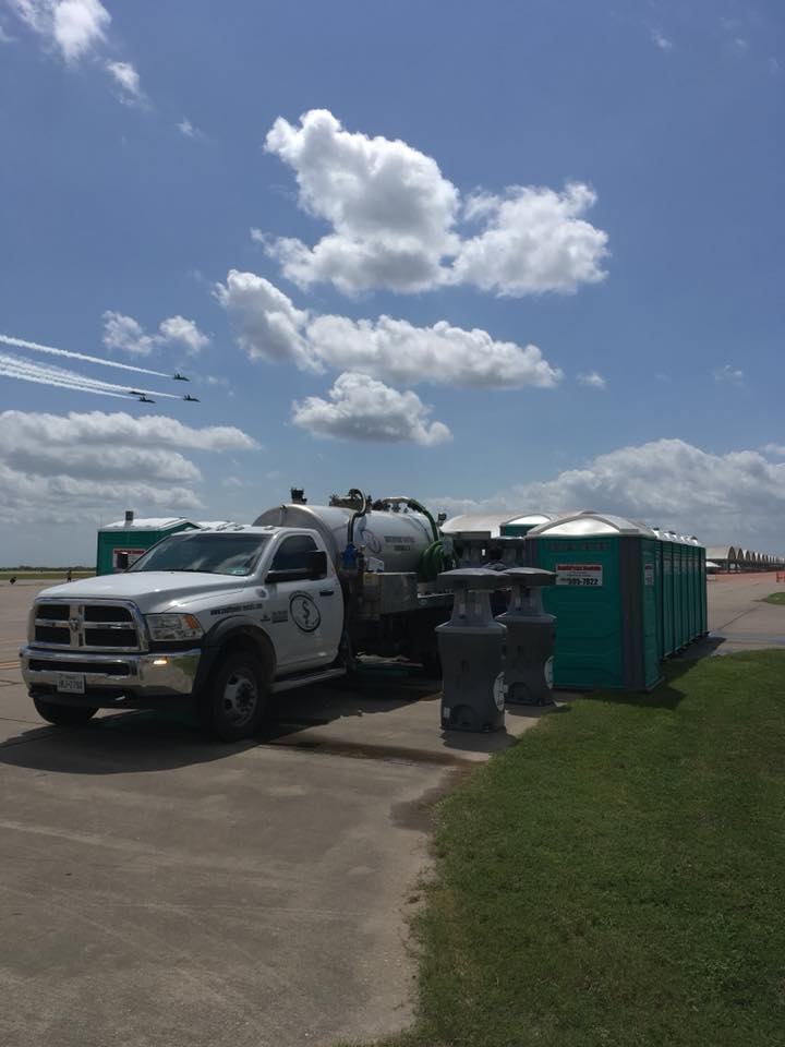 Truck delivering rows of portable restrooms