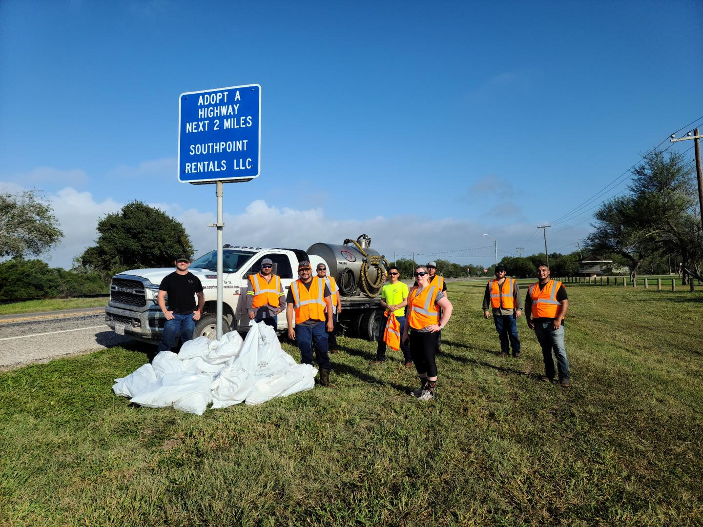 Revealing an Adopt a Highway sign with SouthPoint Rentals