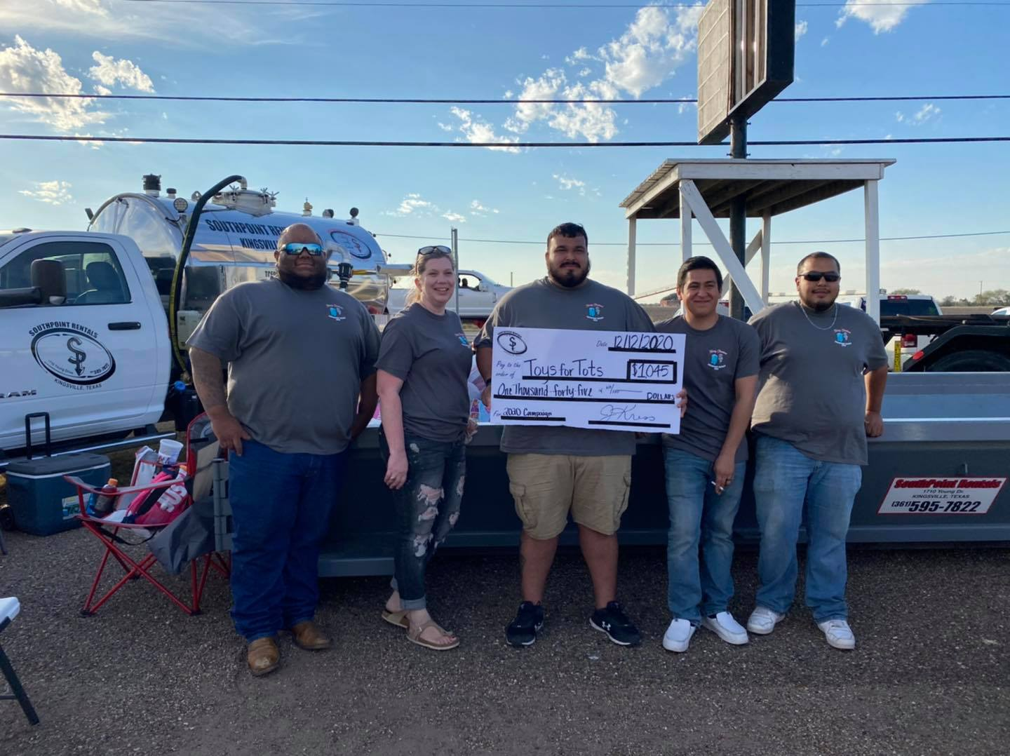 Group photo with check for Toys for Tots